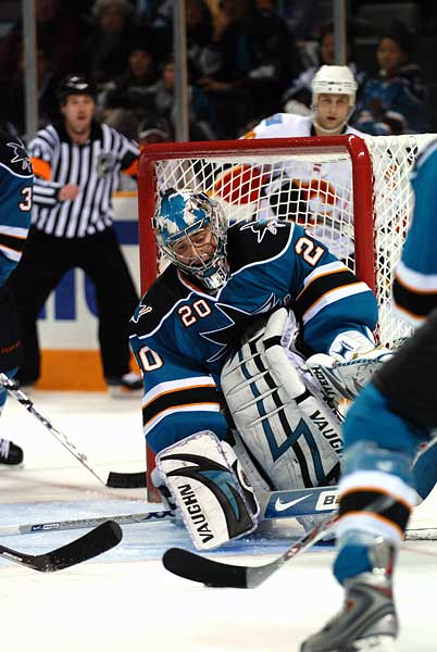 San Jose Sharks goaltender Evgeni Nabokov seals off the post