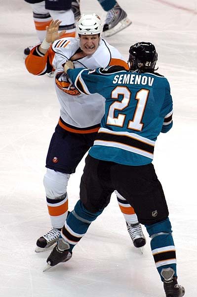 NHL hockey fight Alexei Semenov vs Tim Jackman photo