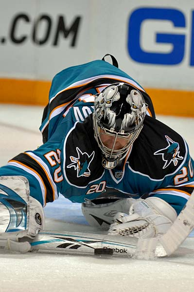 San Jose Sharks goaltender Evgeni Nabokov diving stick save third period