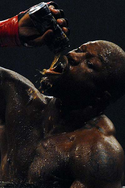 King Mo Lawal showers himself in Rockstar Energy Drink after ko over Matt Lindland Strikeforce Evolution