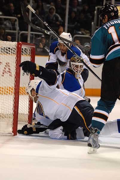 San Jose Sharks St Louis Blues defenseman Barret Jackman glove save