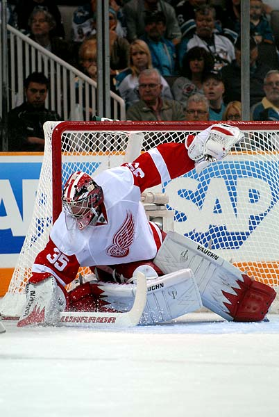 Detroit Red Wings goaltender Jimmy Howard makes a short side save against the San Jose Sharks