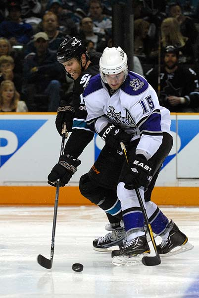 San Jose Sharks Joe Thornton battle for puck with Los Angeles Kings Brad Richardson