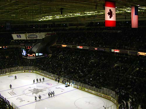 Canadian and American flags during the national anthem