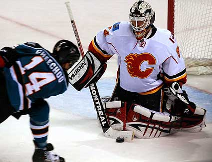 Calgary Flames goaltender Miikka Kiprusoff closed butterfly save