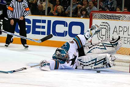 San Jose Sharks goaltender Evgeni Nabokov two pad slide save