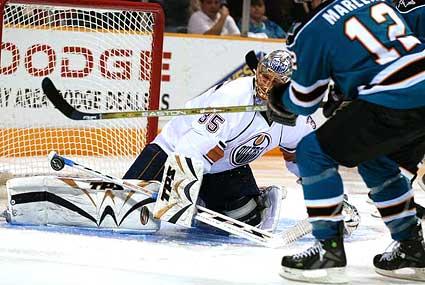 Sharks captain Patrick Marleau scores goal on Edmonton Oilers goaltender Dwayne Roloson