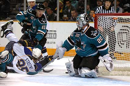 Douglas Murray checks Yan Stastny in front of the net
