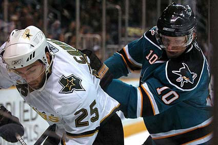 San Jose Sharks defenseman Christian Ehrhoff checks Dallas Stars right wing Chris Connor