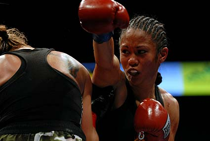 Daly City's Ana Julaton earns 10 round unanimous decision over Donna Biggers for WBO World Super Bantamweight title and first defense of IBA Super Bantamweight title