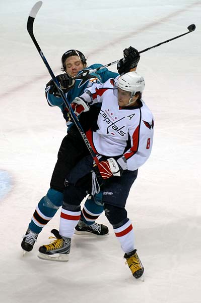 Washington Capitals left wing Alexander Ovechkin checks San Jose Sharks defenseman Douglas Murray hockey hit