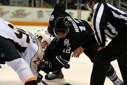 Patrick Marleau Jerred Smithson NHL faceoff photo