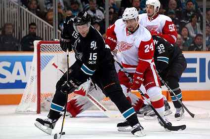 San Jose Sharks right wing Dany Heatley between the legs deflection on goal Detroit