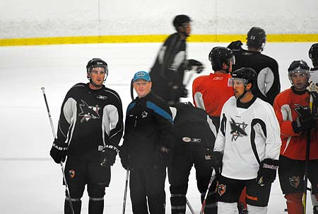 Worcester Sharks assistant coach David Cunniff gives individual instruction at training camp