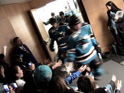 Young fans cheer San Jose Sharks on to the ice to start game NHL