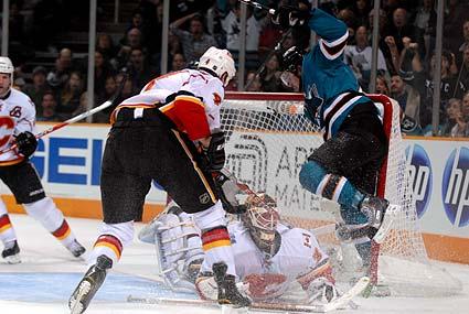 San Jose Sharks Devin Setoguchi major collision Calgary Flames goaltender Miikka Kiprusoff