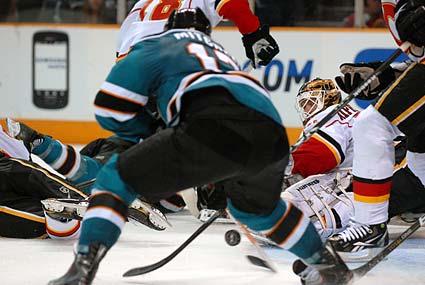 San Jose Sharks center Torrey Mitchell goal Calgary Flames goaltender Miikka Kiprusoff
